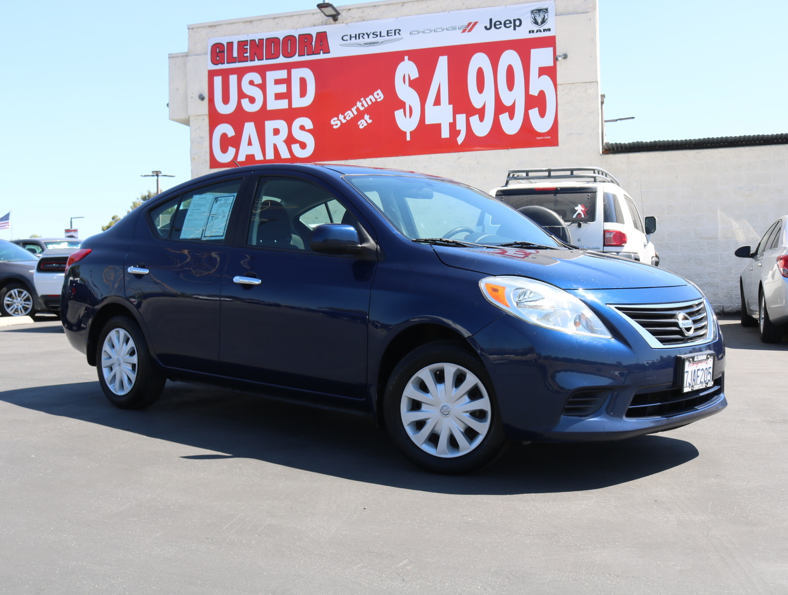 Pre-Owned 2012 Nissan Versa SV